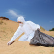 Worker collecting samples from sand — Stock Photo