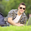Male student working on laptop — Stock Photo