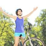 Female biker with raised hands — Stock Photo #45878135
