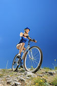 Female biker biking mountain bike — Stock Photo