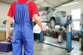 Mechanic in car repair service — Stock Photo