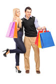 Man and female holding shopping bags — Stock Photo