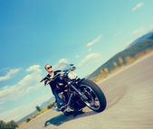 Biker riding customized motorcycle — Stock Photo