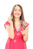 Happy girl blowing bubbles  — Stock Photo