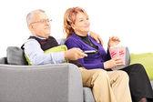 Mature couple watching TV — Stock Photo