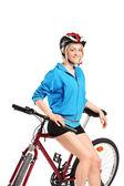 Girl posing on bike — Stok fotoğraf