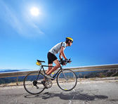Cyclist riding bicycle in Macedonia — Stock Photo