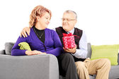 Man giving present to his wife — Stock Photo