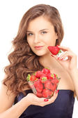 Woman holding bowl of strawberries — Stock Photo