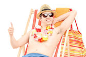 Male on beach chair — Stock Photo