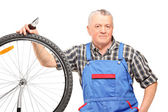Male repairing bicycle wheel — Stock Photo
