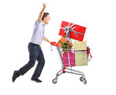 Male pushing shopping cart — Stock Photo