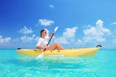 Woman kayaking on sunny day — Stock Photo