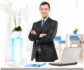 A confident young businessman in his office — Stock Photo