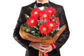 A man holding a large bouquet of flowers — Stock Photo