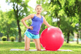 Blond female with pilates ball — Foto de Stock