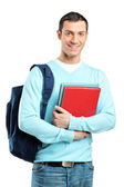 Male student holding books — Stock Photo