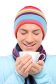 Man holding cup of tea — Stock Photo