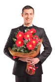 Male holding bouquet — Stock Photo