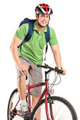 Bicyclist posing on bicycle — Stock Photo
