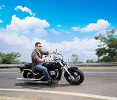 Man riding motorcycle on road — Stock Photo