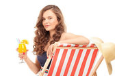 Female sitting on sun lounger — Stock Photo
