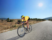 Cyclist riding bike in Macedonia — Stock Photo