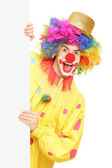 Clown holding blank panel — Stock Photo