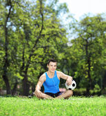 Male athlete with ball in park — Stock Photo