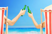 Man and woman cheering with beer — Stock Photo