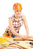 Female carpenter with helmet at work — Stock Photo