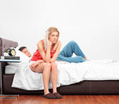 Disappointed blond female on bed — Foto de Stock
