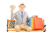 Smiling gentleman with shopping bags — Stock Photo