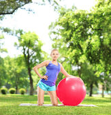 Female athlete with pilates ball — Stock Photo