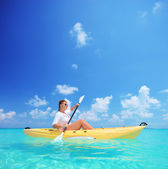 Female in yellow kayak — Stock Photo