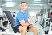 Male lifting weight in a gym — Stock Photo