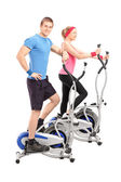 Athletes on cross trainer machine — Stock Photo