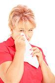Mature woman wiping eye — Photo