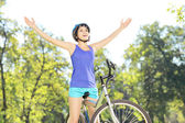 Female biker with raised hands — Stock Photo