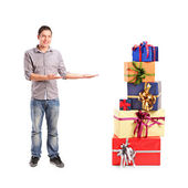 Gesturing and pile of gifts — Foto de Stock