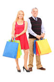 Man and woman holding shopping bags — Stock Photo