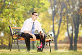 Lonely man drinking alcohol in park — Stock Photo