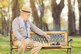 Senior adult playing chess — Stock Photo