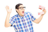 Scared man holding teeth sample — Stock Photo