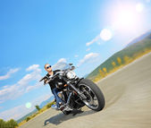 Biker riding customized motorcycle — Stock Photo