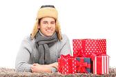 Guy near presents — Stock Photo