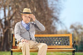 Pensioner with headache — Stock Photo