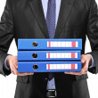 Businessman holding blue folders — Stock Photo