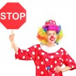 A clown holding a stop sign — Stock Photo #45880241