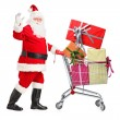 Santa Claus pushing cart full of presents — Stock Photo